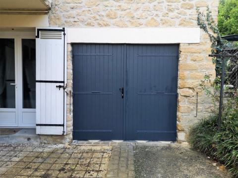 Porte de garage composite